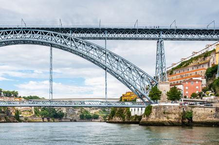 Bridge ove the River Douro in Porto, Portugal. View from the River Douro, one of the major rivers of the Iberian Peninsula (2157 m)