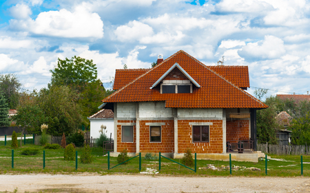 Red roof house in the field of Serbia
