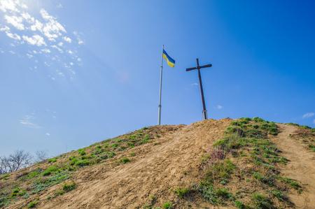 Ukrainian flag and christ on the hill on the island of Hortitsia, Ukraine