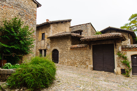 Medieval architecture of Perouges, France, a walled town, a popular touristic attraction. Editorial