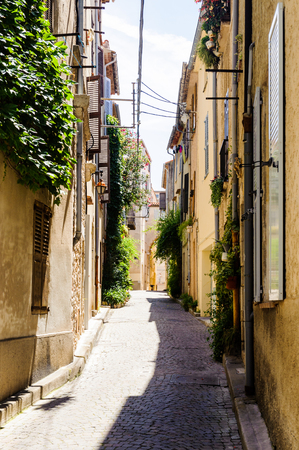 Street in the Old town of Antibes, Cote dAzur, France. Antibes was founded as a 5th-century BC Greek colony and was called Antipolis