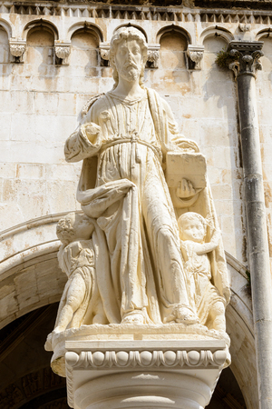 Statue on the Cathedral of St. Lawrence (Katedrala Sv. Lovre), a Roman Catholic triple-naved basilica constructed in Romanesque-Gothic in Trogir, Croatia.