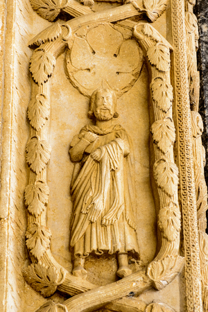 Statue on the Cathedral of St. Lawrence (Katedrala Sv. Lovre), a Roman Catholic triple-naved basilica constructed in Romanesque-Gothic in Trogir, Croatia. UNESCO World heritage Stock Photo
