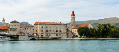 Cathedral of St. Lawrence  a Roman Catholic triple-naved basilica constructed in Romanesque-Gothic in Trogir, Croatia. UNESCO World heritage. And a boat on the Adriatic Sea