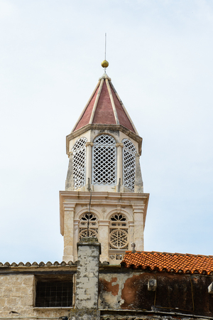 Bell tower of the Cathedral of St. Lawrence (Katedrala Sv. Lovre), a Roman Catholic triple-naved basilica constructed in Romanesque-Gothic in Trogir, Croatia. UNESCO World heritage Stock Photo