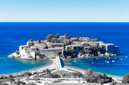 Blue water of the Adriatic sea and the Sveti Stefan Island in black and white, Montenegro