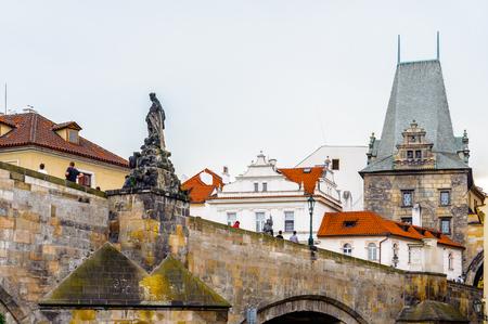 Charles Bridge, a famous historic bridge that crosses the Vltava river in Prague, Czech Republic.