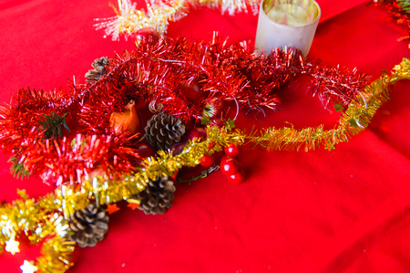 Christmas tree decoration objects on the red tissue