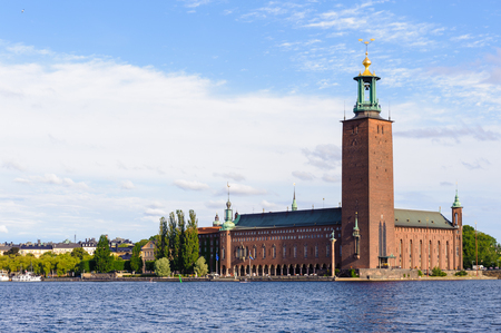 Stockholm City Hall, the building of the Municipal Council for the City of Stockholm in Sweden over the lake Malaren
