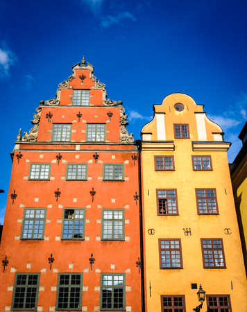Red and Yellow iconic buildings on Stortorget,  a small public square in Gamla Stan, the old town in central Stockholm, Sweden. Editorial