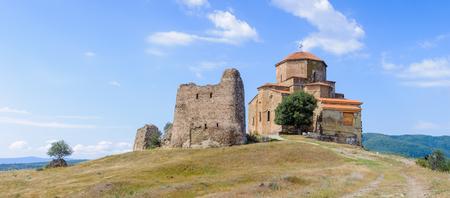 Beautiful nature and Jvari Monastery, Georgian Orthodox monastery of the 6th century on the mountain hill ove the old town of Mtskheta Stock Photo