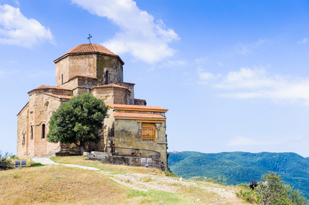 Beautiful nature and Jvari Monastery, Georgian Orthodox monastery of the 6th century on the mountain hill ove the old town of Mtskheta Editorial