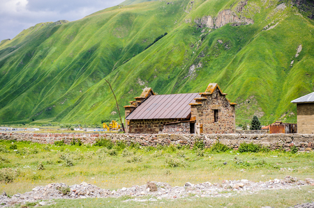 Houses in front of the green mountains of Georgia