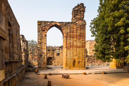 Qutb Mosque Arch Ruin at the Qutb complex (Qutub),  an array of monuments and buildings at Mehrauli in Delhi, India. UNESCO World Heritage Site Stock Photo