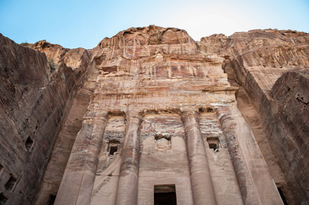 One of the multiple dwellings in Petra (Rose City), Jordan. The city of Petra was lost for over 1000 years. Now one of the Seven Wonders of the Word Stock Photo