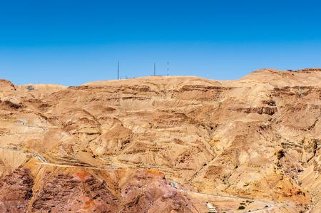 Dunes of a desert underneath the blue sky