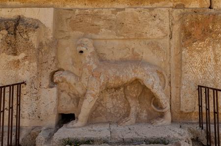 Sculpture of the lion on  the Ruins of the Qasr al Abd in Iraq Al Amir, Jordan.