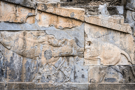 Ancient stone relief in Persepolis, the ceremonial capital of the Achaemenid Empire. Imagens