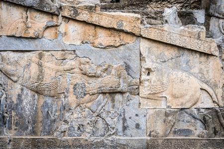 Ancient stone relief in Persepolis, the ceremonial capital of the Achaemenid Empire. Archivio Fotografico