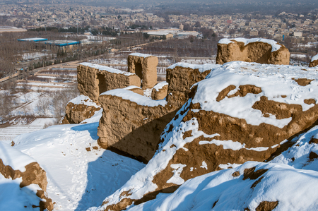 Fire temple of Isfahan mountain in winter with snow Stock Photo