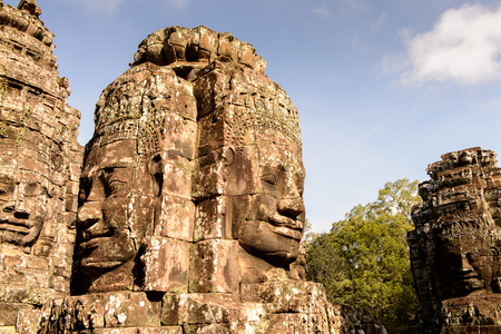 Smiling faces of the Bayon, Khmer temple at Angkor in Cambodia. Official state temple of the Mahayana Buddhist King Jayavarman VII Stock Photo