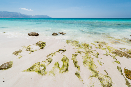Stones on the calm coast of the ocean Stock Photo