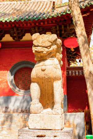 Lion statue at the Authentic Shaolin Monastery (Shaolin Temple), a Zen Buddhist temple.