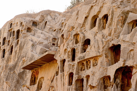 Caves at the Longmen Grottoes ( Dragons Gate Grottoes) or Longmen Caves.