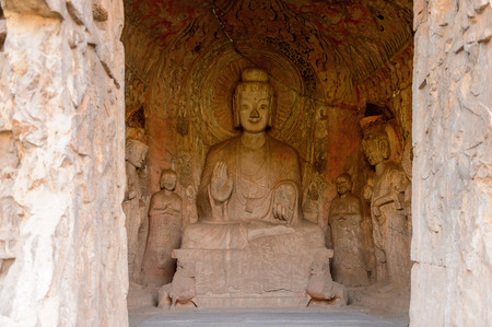 Buddha statue at the Longmen Grottoes ( Dragons Gate Grottoes) or Longmen Caves.UNESCO World Heritage of tens of thousands of statues of Buddha and his disciples Editorial