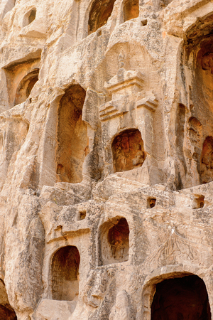 Longmen Grottoes (Dragons Gate Grottoes) or Longmen Caves. Tens of thousands of statues of Buddha and his disciples.