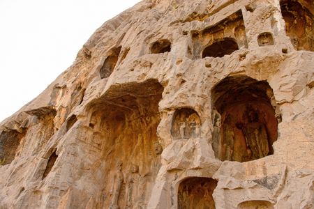 Longmen Grottoes ( Dragons Gate Grottoes) or Longmen Caves Tens of thousands of statues of Buddha and his disciples Standard-Bild