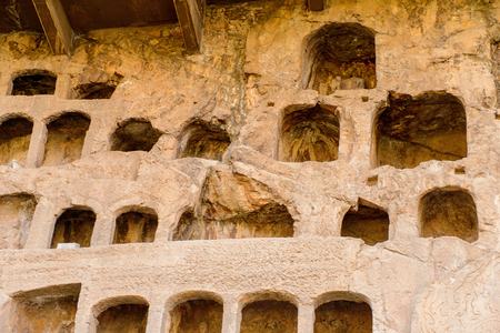 Caves at the Longmen Grottoes ( Dragon's Gate Grottoes) or Longmen Caves. Stock Photo