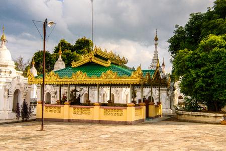 Kuthodaw Pagoda (Mahalawka Marazein), (Royal Merit), is a Buddhist stupa, in Mandalay, Burma (Myanmar), that contains the worlds largest book. Stock Photo