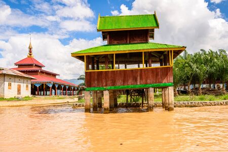 Wooden houses of the Inpawkhon village over the Inle Sap,a freshwater lake in the Nyaungshwe Township of Taunggyi District of Shan State, Myanmar