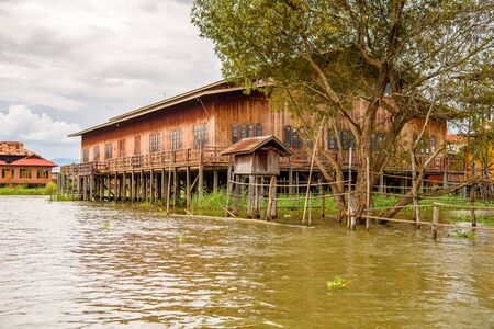 Wooden house of the Inpawkhon village over the Inle Sap,a freshwater lake in the Nyaungshwe Township of Taunggyi District of Shan State, Myanmar Stock Photo