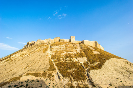 Citadel of Aleppo, a large medieval fortified palace in the centre of the old city of Aleppo, northern Syria. It is considered to be one of the oldest and largest castles in the world. Фото со стока