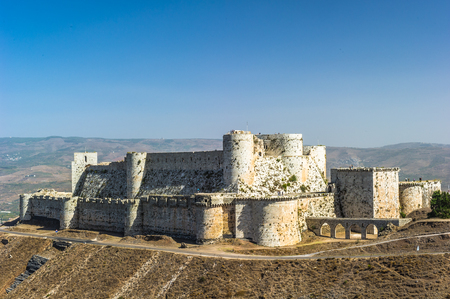 Krak des Chevaliers, also Crac des Chevaliers, is a Crusader castle in Syria and one of the most important preserved medieval castles in the world. Фото со стока - 92272267