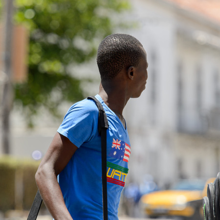 SAINT LOUIS, SENEGAL - APR 24, 2017: Unidentified Senegalese boy in blue shirt holds a bag in the centre of Saint Louis, one of the major cities in Senegal Editorial
