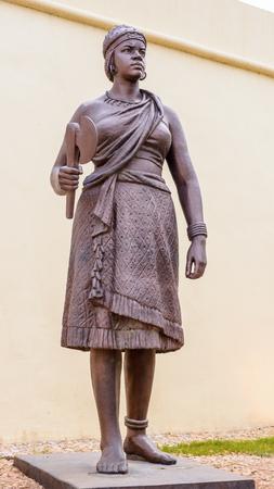 LUANDA, ANGOLA - MAR 4, 2013: Statue of Woman in Luanda, formerly named Sao Paulo da Assuncao de Loanda, is the capital and largest city of Angola. Luanda is both Angolas chief seaport and its administrative center.
