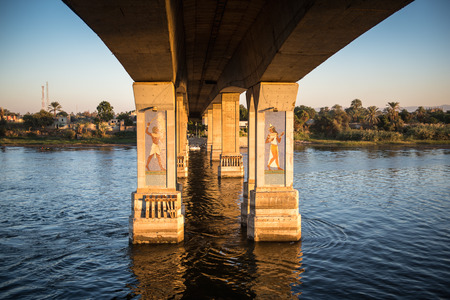 "LUXOR, EGYPT - NOV 30, 2014: Bridge over the river NIle near Luxor. Nile is 6,853 km long. The Nile is an ""international"" river shared by eleven countries"
