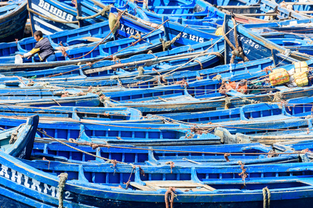 ESSOUIRA, MOROCCO - OCT 2, 2015: Typical blue fishing boat on the coast of Essouira, Morocco. The city was called Sidi Megdoulin in 11th-century