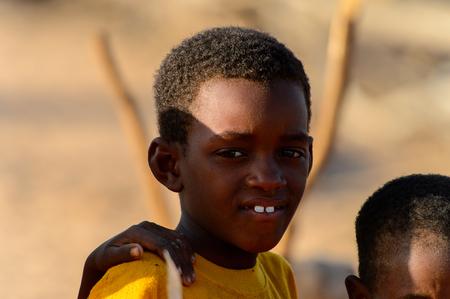 FERLO DESERT, SENEGAL - APR 25, 2017: Unidentified Fulani little boy looks ahead. Fulanis (Peul) are the largest tribe in West African savannahs