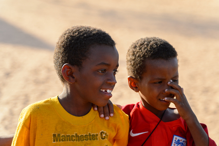 FERLO DESERT, SENEGAL - APR 25, 2017: Unidentified Fulani little boys look away. Fulanis (Peul) are the largest tribe in West African savannahs Editorial