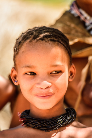 EAST OF WINDHOEK, NAMIBIA - JAN 3, 2016: Unidentified bushman beautiful girl. Bushman people are members of various indigenous hunter-gatherer people of Southern Africa