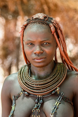 KAMANJAB, NAMIBIA - SEPTEMBER 07, 2015: Unidentified woman from Himba tribe. The Himba are indigenous people living in northern Namibia and Angola