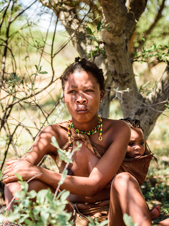 EAST OF WINDHOEK, NAMIBIA - JAN 3, 2016: Unidentified bushman woman. Bushman people are members of various indigenous hunter-gatherer people of Southern Africa