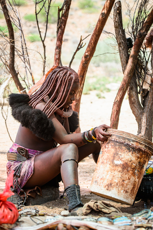 KAMANJAB, NAMIBIA - SEPTEMBER 07, 2015: Unidentified woman from Himba tribe. The Himba are indigenous people living in northern Namibia and Angola Stock fotó - 103810243