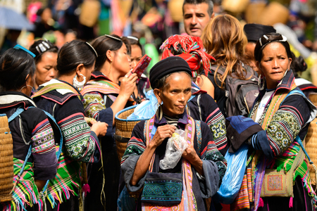 SAPA, VIETNAM - SEP 20, 2014: Unidentified Hmong women wearing the traditional costume to attract the tourists. Hmong people is a minority ethnic group living in Sapa