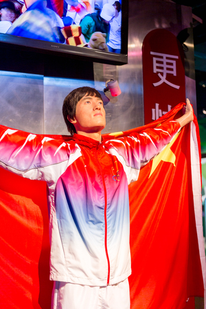 SHANGHAI, CHINA - APR 3, 2016: Liu Xiang at the Shanghai Madame Tussauds wax museum. Marie Tussaud was born as Marie Grosholtz in 1761 報道画像