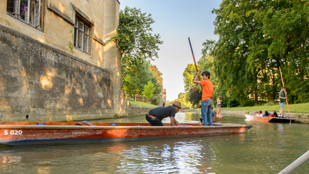 CAMBRIDGE, ENGLAND - JULY 19, 2016: Unidentified man sails in a boat over the river Cam, Cambridge, England. The original name was the Granta river